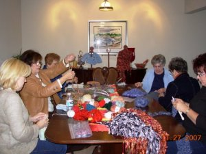 The Knotty Knitters prepare their creations for the Holiday Homes Tour Boutique