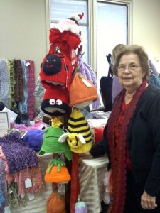 A fellow knitter shows some of the whimsical items sold at the Boutique